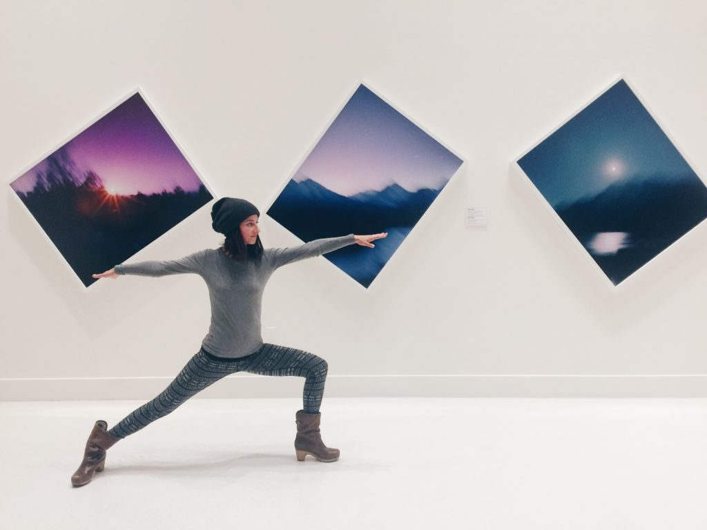 Ilona Barnhart in warrior two at a Photography Museum Art