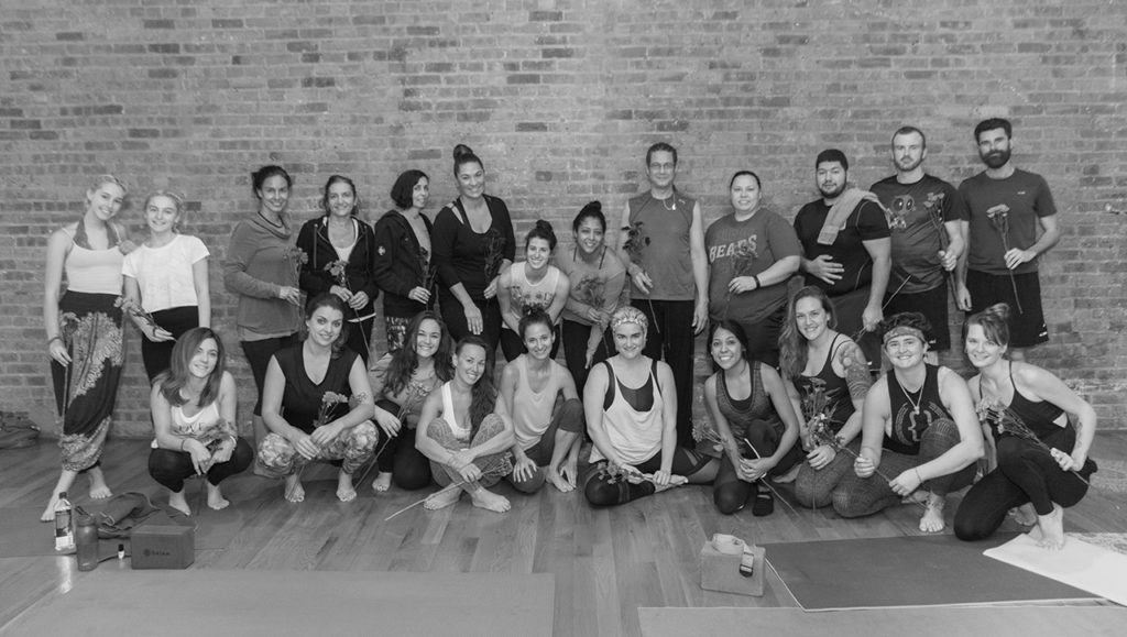 Yoga Workshop and class with Ilona Barnhart in Chicago IL. Brick wall at Loft Yoga Chicago and students