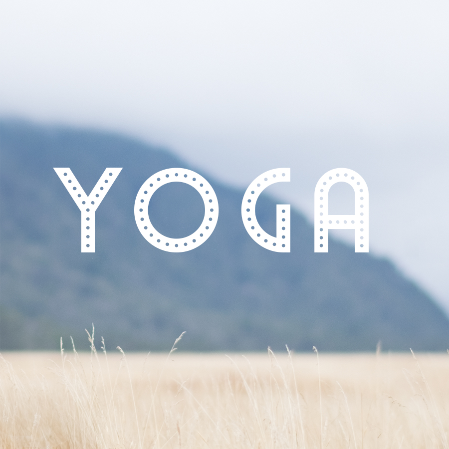 New Zealand landscape with letters spelling yoga